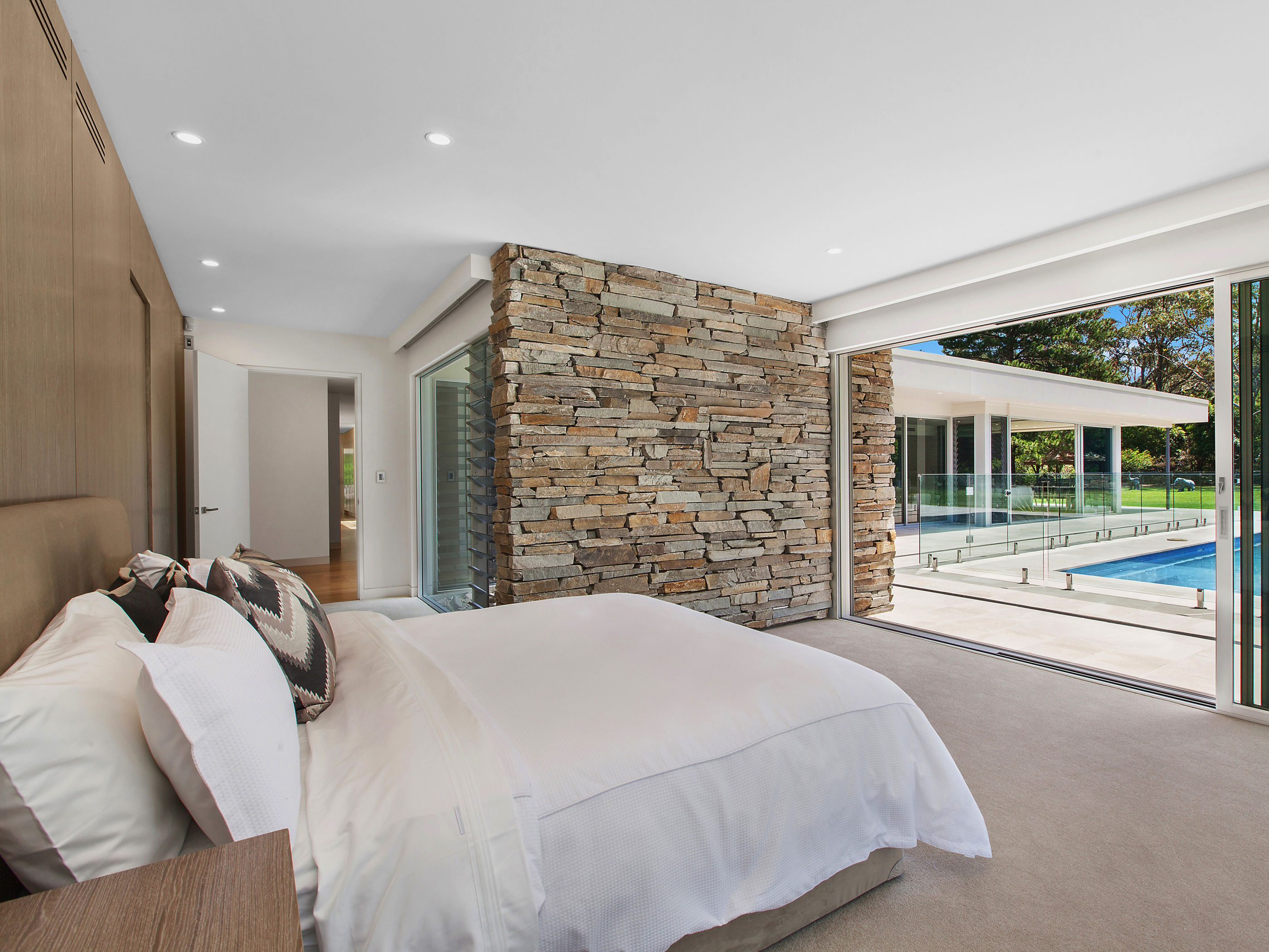 A feature blade wall running internally to externally in a residential design with Baw Baw Dry Stone walling