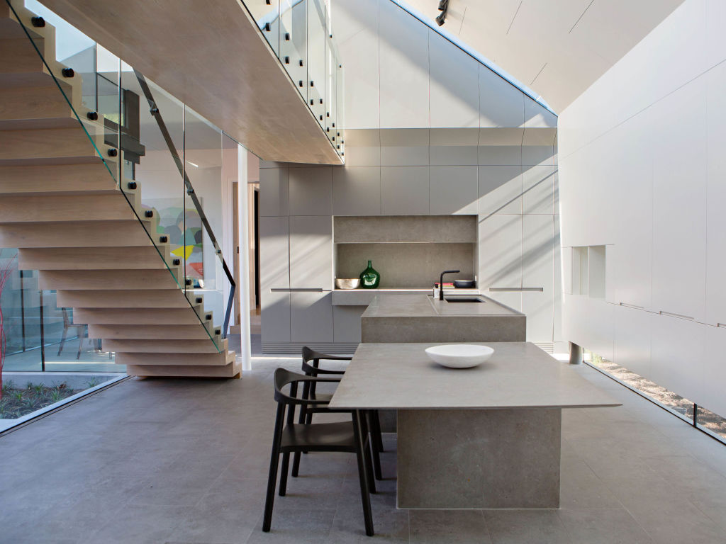 Seville stone used as all flooring and custom cantilevered bench
