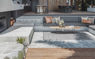 Stone paving vs timber decking