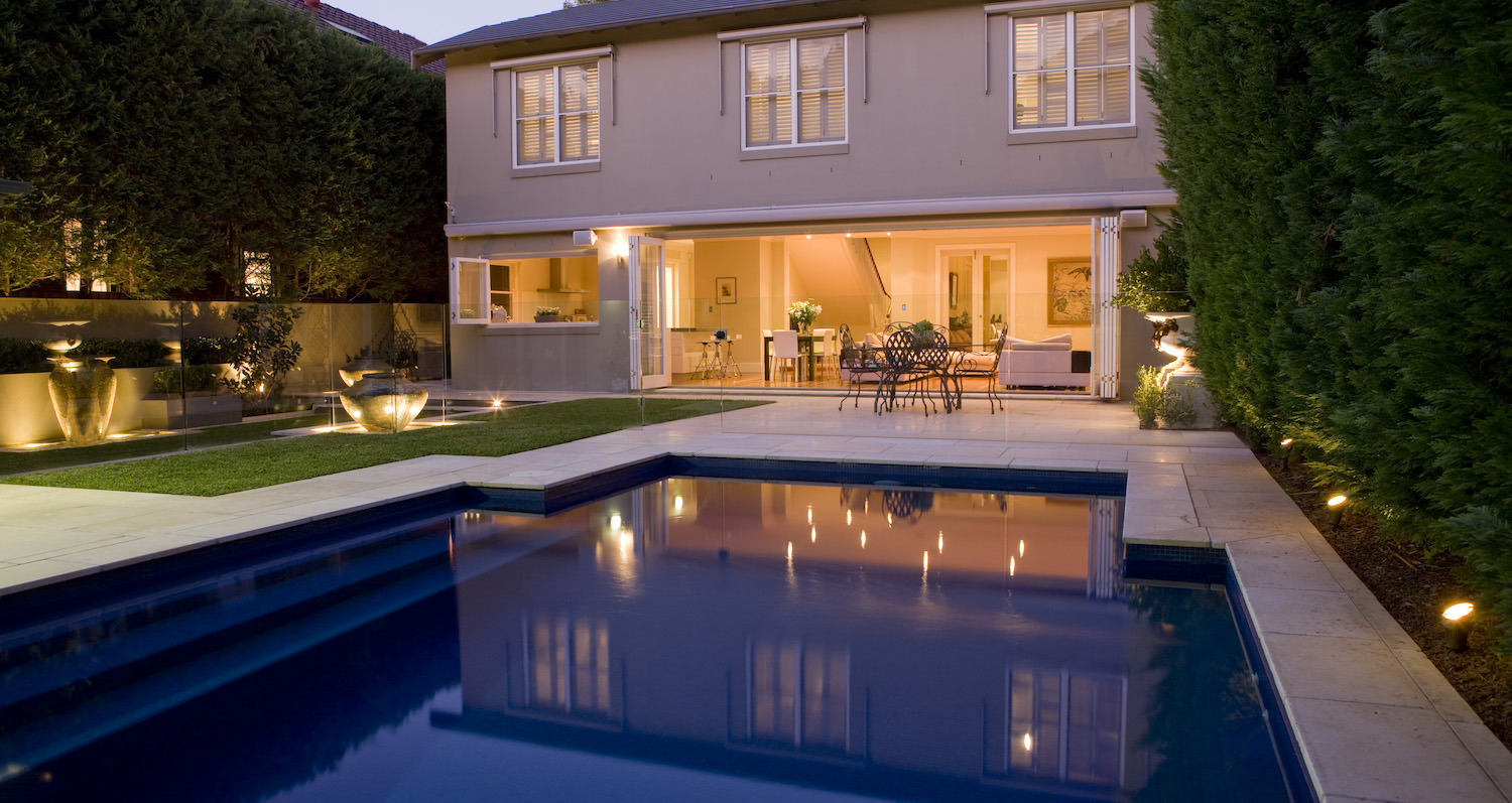 Well-curated lighting poolside can enhance your space and extend its usage | Landart Landscapes